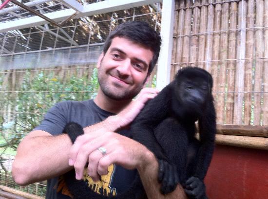 Foundation Jaguar Rescue Center: hubby holding mid-size howler monkey