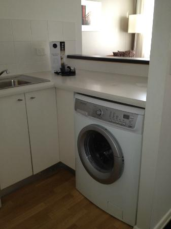 The Sebel Brisbane: Washing machine in the kitchenette