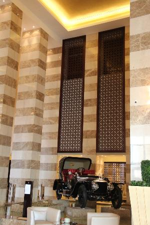 The St. Regis Doha: Lobby with antique Rolls Royce