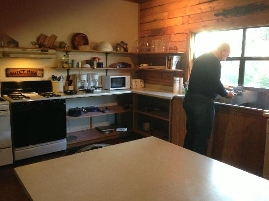 Quiet Hill Ranch - Fredericksburg: Common Kitchen where hubby is cooking breakfast