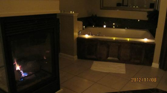 Beautiful jacuzzi with 3 way fireplace picture of for Three way fireplace