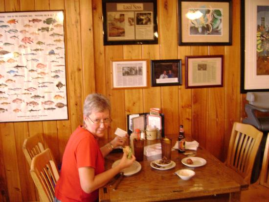 Hyman's Seafood: Donna chompin on a Crab Cake at Hyman's