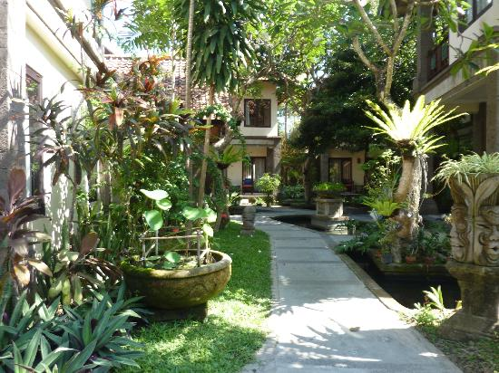 Puri Mesari Hotel & Suites: A walk through the gardens to some of the rooms