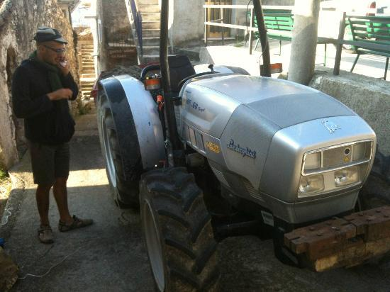 Italy Farm Stay: Antonello, with the Lamborghini Tractor at Via Piana.