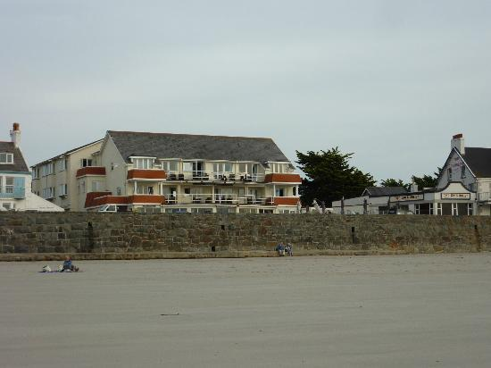 Cobo Bay Hotel - from the beach at low tide (note how high the wall is)