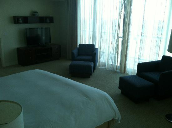 Hilton Fort Lauderdale Beach Resort: Penthouse spacious master bedroom with TV, chairs, & oceanfront view