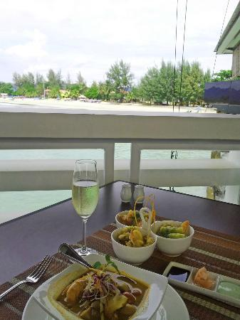 The Cliff Restaurant & Bar: Seafood tempura, spicy King Prawn soup, accompanied with a glass of Prosecco and stunning ocean