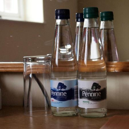 Bourne Valley Inn: Bottles of water in my room.