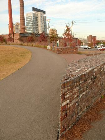 """Birmingham's Railroad Park : Great use of """"loose brick"""" walls, held in place by screens"""