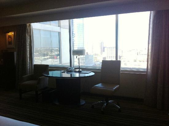 Hilton Americas - Houston: desk/seating area with view of park and conference center