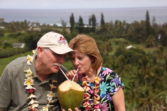 Open Eye Tours & Photos: Sharing a coconut with my husband.