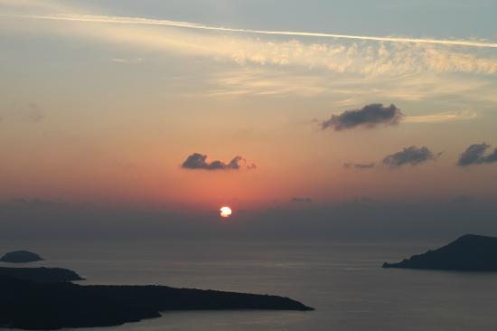 Mill Houses Elegant Suites : The Sun set of Santorini from the hotel terrace - The best of all