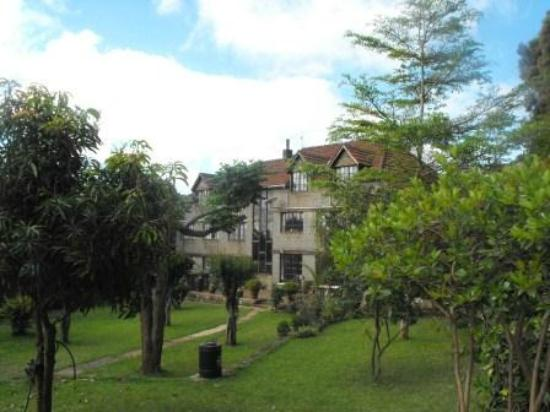 "Kikuyu Lodge Hotel & Safaris: View of the lodge from the grounds (""park like"" setting)."