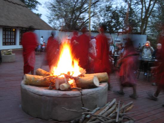 Ngorongoro Farm House, Tanganyika Wilderness Camps: Maasai dancing on patio