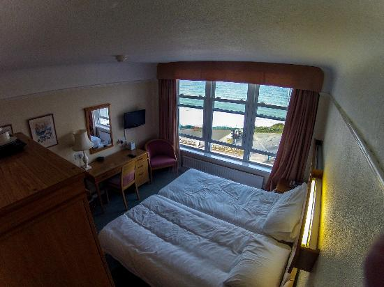 Best Western Hotel Bristol: Hotel room from one corner, looking out the window at the beach