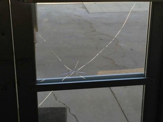 Highland Hotel and Convention Center: Shattered glass on west entry door