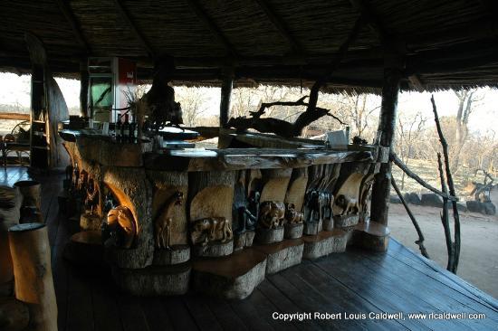 Kikoti Safari Camp: The bar with hand carved animals at it's base