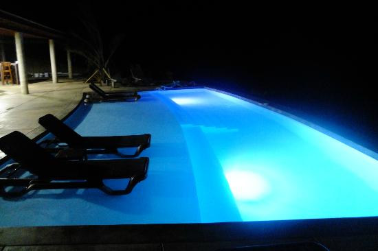 Pagua Bay House Oceanfront Cabanas: Pool - evening