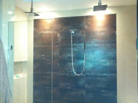 Oasis12: massive shower with his and her rain heads and a wall one too even a bench in this shower!!