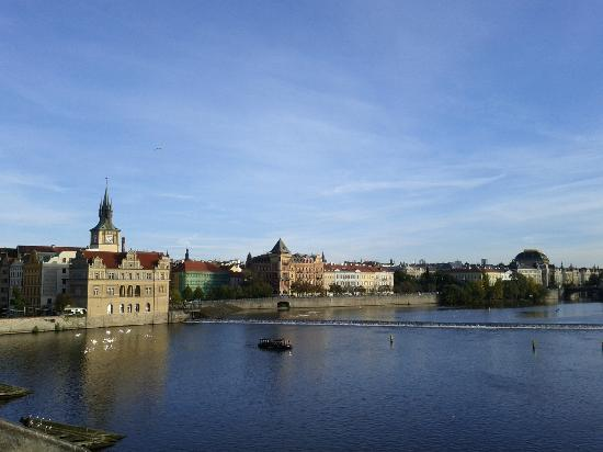 Pachtuv Palace: View from Charles bridge. The building with green mesh is the hotel.