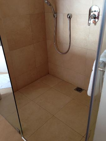 """Asara Wine Estate & Hotel: The bathroom tiles were 16x16"""" polished marble, very dangerous: extremely slippery when wet."""