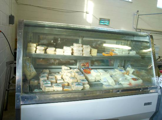 Tucumcari Mountain Cheese Factory: Cheese display to left of and just inside door