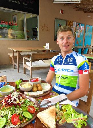 my hungry cyclist husband enjoying a hearty lunch