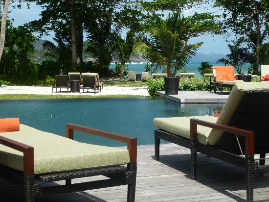 Constance Ephelia: lounging around the pool, with view across the bay