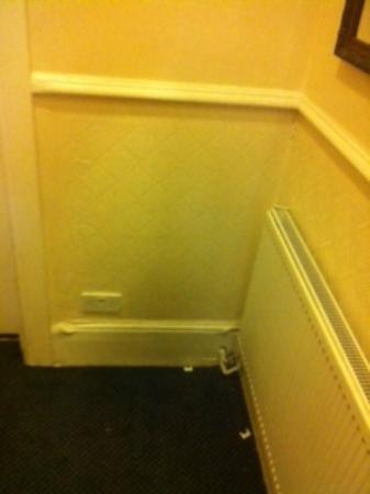 Arran House Hotel: grubby paintwork and messy staircase