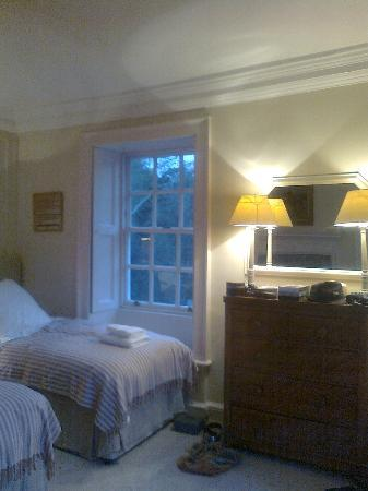 Restormel Manor & Cottages: the second twin bedded room with views of the river and old fashioned window shutters