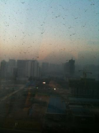Yulong International Hotel: sunrise in xi'an, with the smog and dirty windows