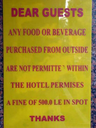 Saint Joseph Hotel : Yellow sign - a 500 EP spot fine if found consuming your own food or drinks