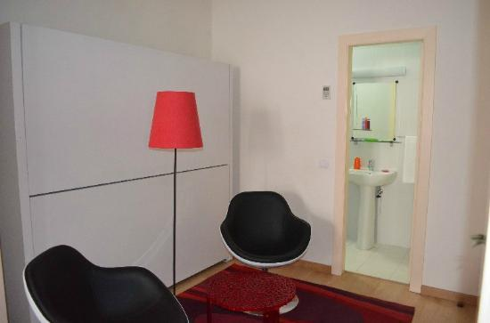 Evora Inn Chiado Design: Exuberancia Suite sitting area and ensuite bathroom