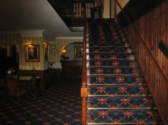 Abbeyglen Castle Hotel: Staircase up to the guest rooms and the hotel dining room
