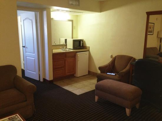 Ramada Tempe Near ASU: living room in suite, older stuff but very clean and well maintained.