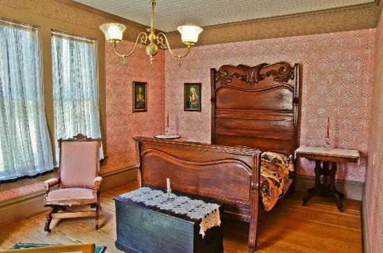 Hughes Historic House: One of the several bedrooms in the Hughes House