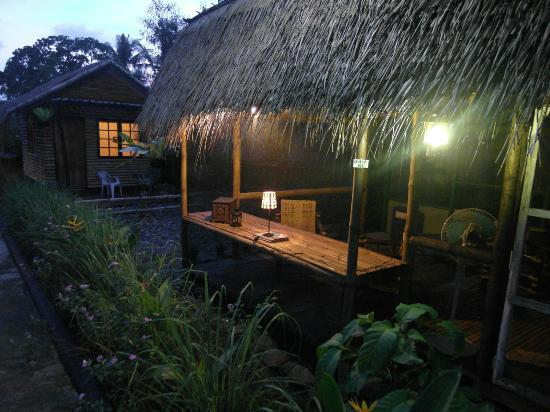 Subli Guest Cabins: library hut at dawn