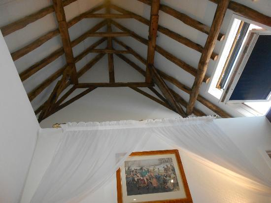 Exposed Roof Beams Skylight That Opens Picture Of Hotel