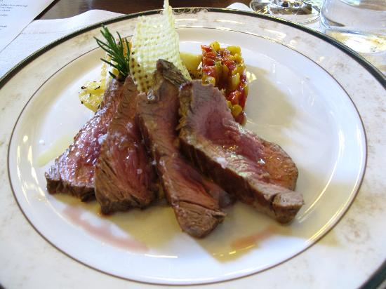 Montalcino, Italy: Baked sirloin steak with rosemary flavoured potatoes