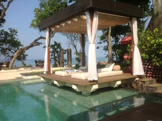 The Seminyak Beach Resort & Spa : one of the pools with comfy chairs in a secluded setting