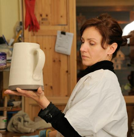 Nicholas Mosse Pottery : Slipping a medium cylinder jug.