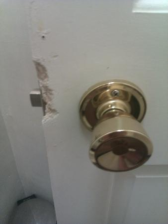 Park Hotel: Final photo of the bady damaged bathroom door