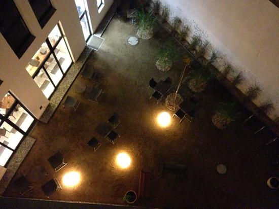 Almodovar Hotel: courtyard at night from bedroom on 3rd floor