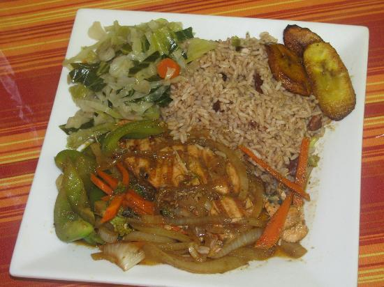 stewed oxtail with rice  peas steamed vegetables and