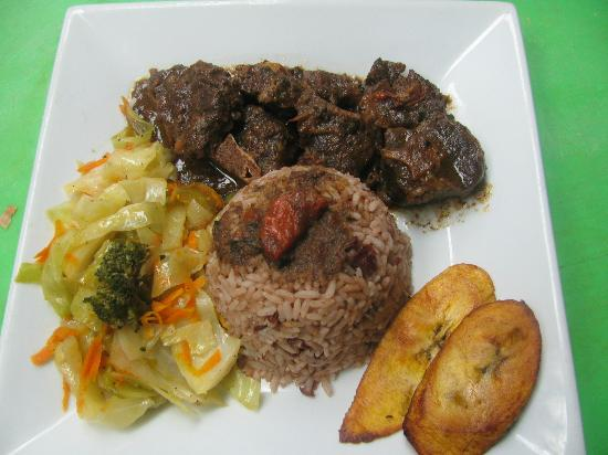 Rhythm & Spice Jamaican Gril: Stewed Oxtail with Rice & Peas, Steamed Vegetables and Plantains