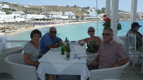 Petinos Beach Hotel: Dining with friends in casual restaurant overlooking sea/beach.