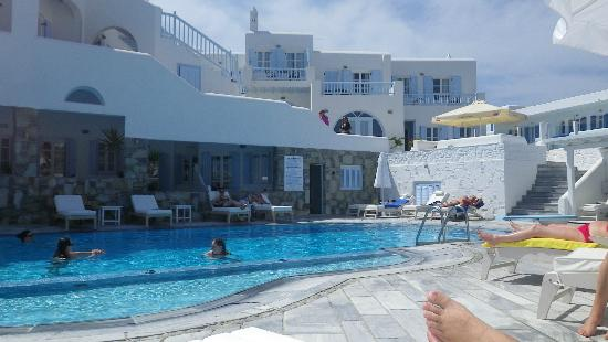 Petinos Beach Hotel: From lounger on other side from previous pool photo. There is a shower.