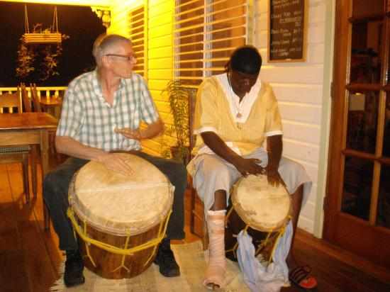 Hickatee Cottages: Ian and Ronald Raymond McDonald Garifuna drumming on the porch of Charlie's Bar