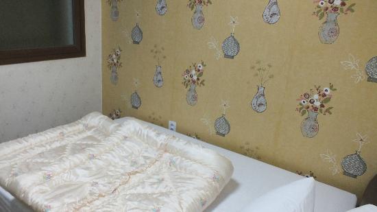 Goodstay Petercat Hotel Insadong: シングルルームのベッド