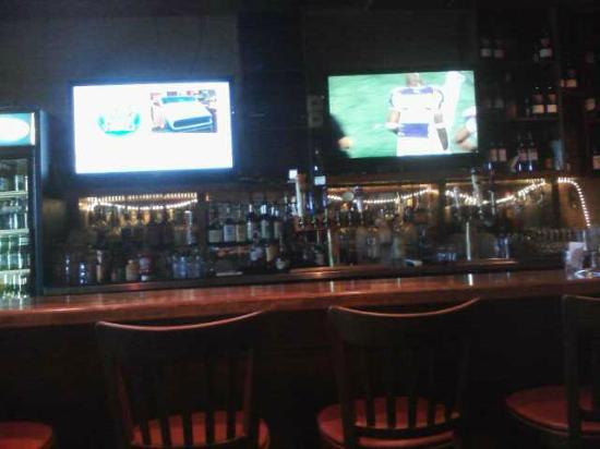 Nassau Grill & Bar: Bar area and TVs